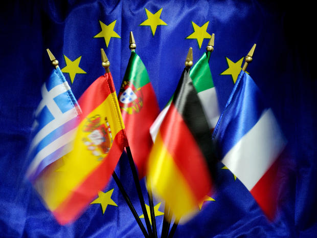 Flags of European countries are displayed in front of a flag of European Union on September 4, 2012, in France