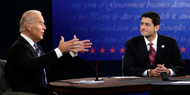 Republican vice presidential nominee Rep. Paul Ryan, of Wisconsin, right, listens as Vice President Joe Biden speaks during the vice presidential debate at Centre College, Thursday, Oct. 11, 2012, in Danville, Ky.