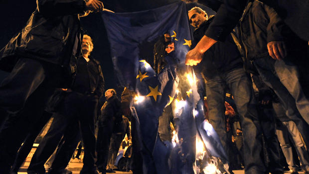 Protesters in Athens, Greece, on March 4, 2010, burn an E.U. flag.