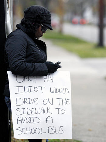 "Ohio driver sentenced to hold ""idiot"" sign"