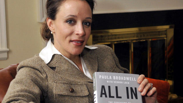 Paula Broadwell, author of the David Petraeus biography 'All In,' poses for photos in Charlotte, North Carolina