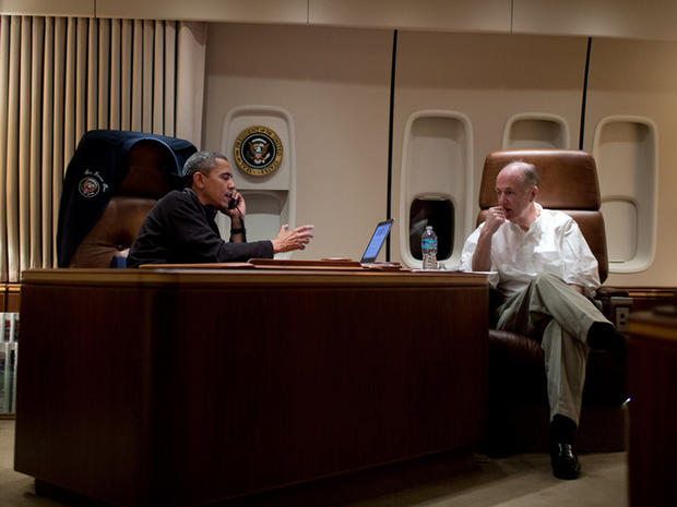 President Obama, aboard Air Force One, talks on the phone with Egyptian President Mohammed Morsi