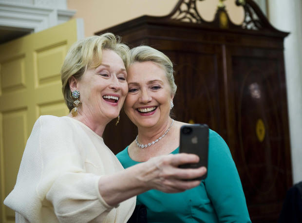 Actress Meryl Streep uses her iPhone to get a photo of her and Secretary of State Hillary Rodham Clinton following the State Department Dinner for the Kennedy Center Honors gala Saturday, Dec. 1, 2012 at the State Department in Washington.