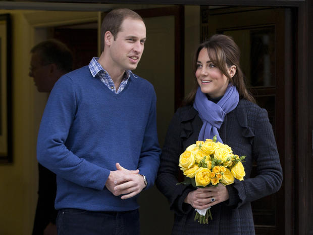 Britain's Prince William stands next to his wife Kate, Duchess of Cambridge as she leaves the King Edward VII hospital in central London, Thursday, Dec. 6, 2012. Prince William and his wife Kate are expecting their first child, and the Duchess of Cambridg