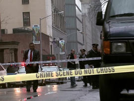 Police respond to the scene of a fatal shooting on West 58th Street on Dec. 10, 2012