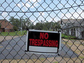 In this July 13, 2011 photo, the buildings that housed the Dozier School for Boys is locked after if closed.