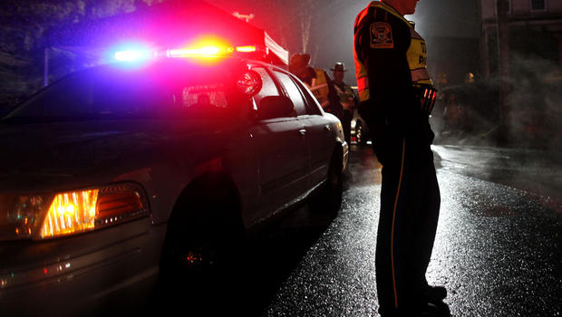 A Connecticut state trooper mans a checkpoint on the road leading toward Sandy Hook Elementary Dec. 17, 2012, in Newtown, Conn.