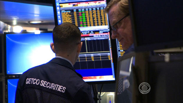 Traders on the floor of the New York Stock Exchange on Wall Street.