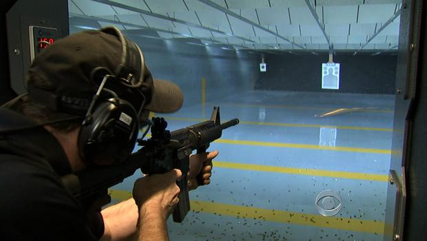 A man target practices at a shooting range.