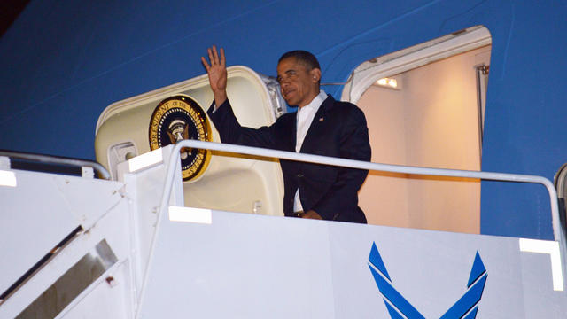 President Obama steps off Air Force One upon arrival at Hickam Air Force Base near Honolulu