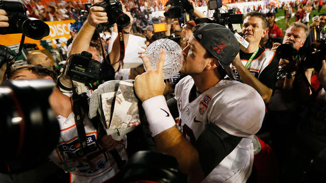 AJ McCarron, of Alabama, celebrates with Coach's Trophy after Crimson Tide beat Notre Dame, 42-14, to win BCS title in Sun Life Stadium in Miami Gardens, Fla.on January 7, 2013