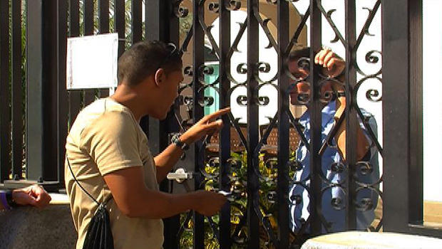 Berni Tornes speaks to a Canadian Embassy official through the gate.