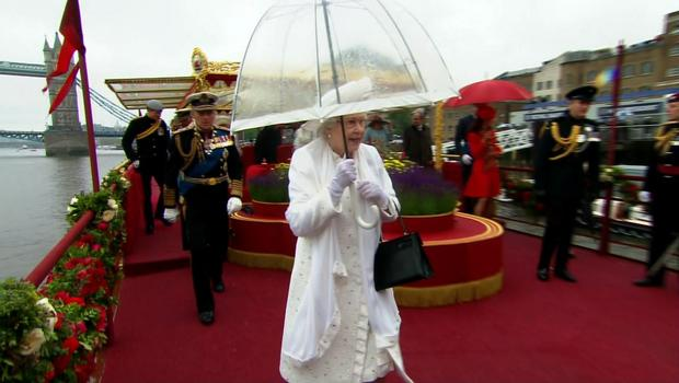 Queen Elizabeth shields herself from the rain during the Diamond Jubilee in June 2012.