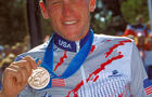 Lance Armstrong celebrates his bronze medal in the men's road cycling individual time trial at the Sydney Olympic Games Sept. 30, 2000.