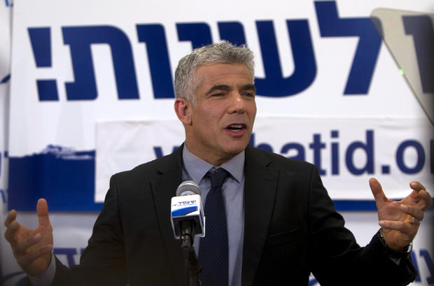 Yair Lapid, leader of the Yesh Atid (There is a Future) party, speaks to supporters
