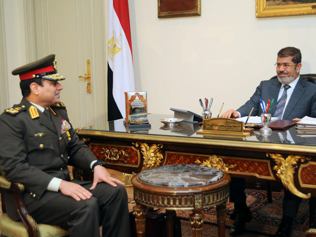 President Mohammed Morsi, right, meets Lt. Abdul Fattah El-Sissi