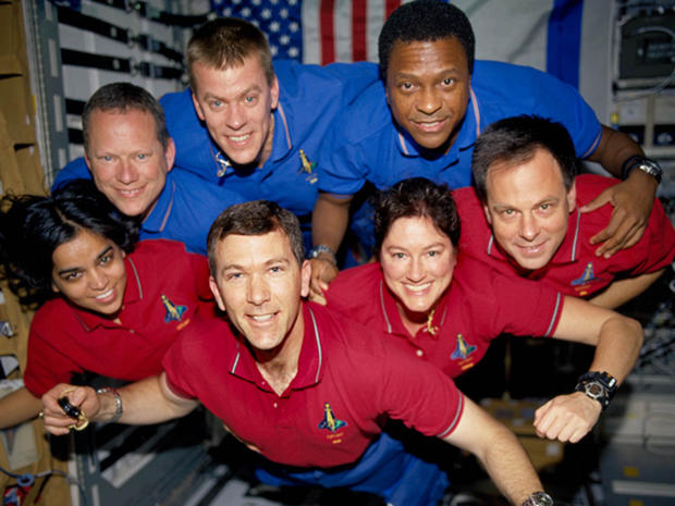 The Columbia astronauts, posing for a group photo during their 16-day science mission. Back row, left to right: David Brown, pilot William McCool, Michael Anderson. Front row, left to right: Kalpana Chawla, commander Rick Husband, Laurel Clark, Israeli flier Ilan Ramon. (CREDIT: NASA)
