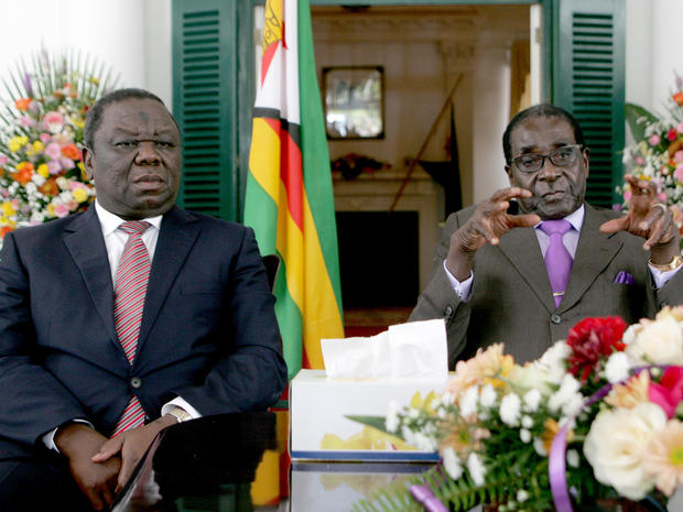 Zimbabwe's President Robert Mugabe (R) and Prime Minister Morgan Tsvangirai (L) announce the conclusion of the constitution making process at State House.