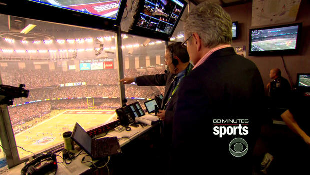 Frank Supovitz, NFL senior vice president, points to the field in the Super Dome from the NFL control room as soon as the lights went off during the Super Bowl on February 3, 2013.