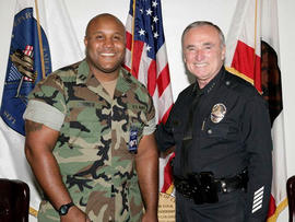 This undated photo released by the Los Angeles Police Department shows suspect Christopher Dorner, a former Los Angeles officer with former Police Chief William Bratton.