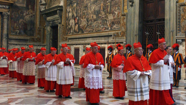In this photo from files taken on April 18, 2005 and released by the Vatican paper L'Osservatore Romano, Cardinals walk in procession to the Sistine Chapel at the Vatican, at the beginning of the conclave.