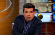 George Lopez does his best Charlie Rose