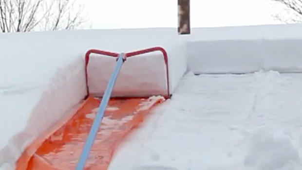 Oddly Effective Snow Removal Technique For The Roof Cbs News