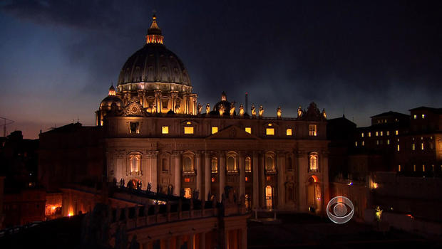 St. Peter's Basilica is pictured at night.