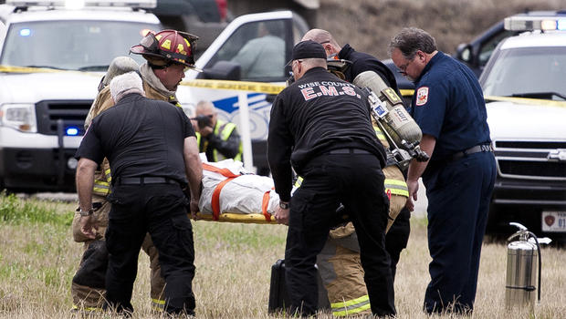 Suspect is carried on a stretcher following a car chase and crash in northern Texas.