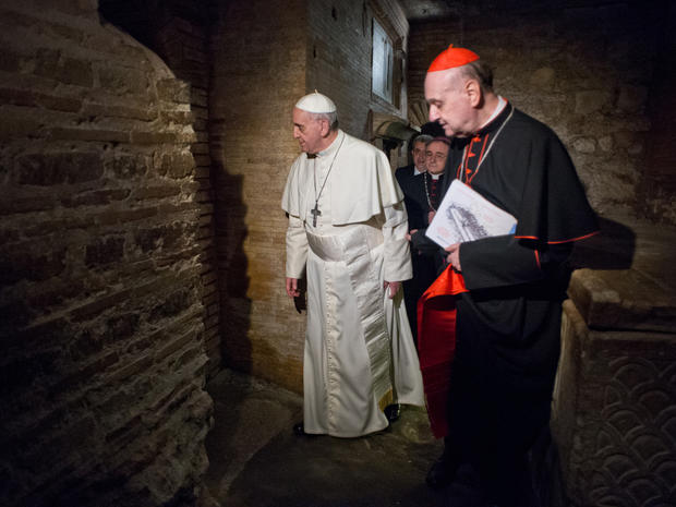Pope Francis, followed by Cardinal Angelo Comastri, right, and Bishop Vittorio Lanzani, partially hidden, visits the necropolis on April 1, 2013.