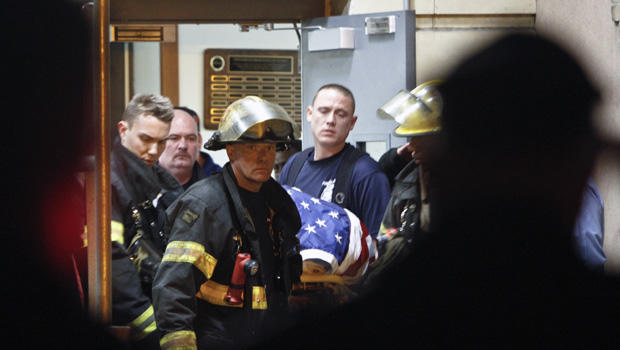 Fellow firefighters carry the body of fallen firefighter Capt. Michael Goodwin at Thomas Jefferson Hospital in Philadelphia, Saturday, April 6, 2013.