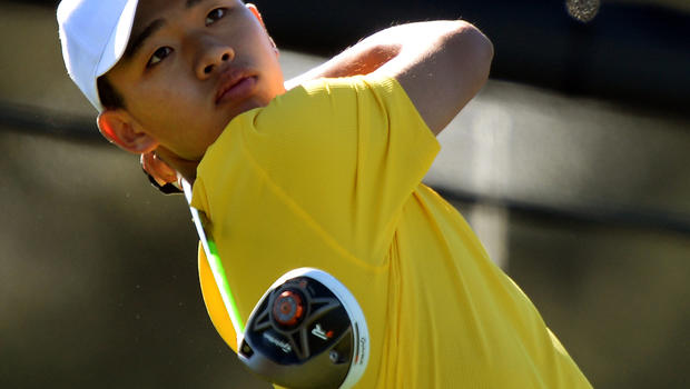 Tianlang Guan of China plays during the third round of the 77th Masters golf tournament at Augusta National Golf Club April 13, 2013, in Augusta, Ga.