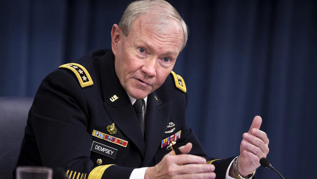 In this March 28, 2013 file photo, Joint Chiefs Chairman Gen. Martin Dempsey gestures while speaking during a news conference at the Pentagon.