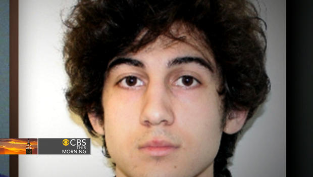 Dzhokhar Tsarnaev left a note behind in the boat he hid in as police chased him, sources tell CBS News correspondent John Miller