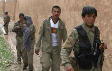 U.S. troops train Afghan police to fight the Taliban