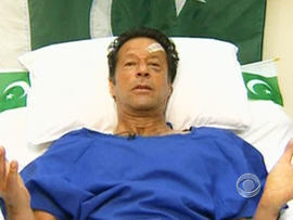 Imran Khan greeted his supporters at his final political rally Thursday from his hospital bed.