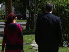 A victim of domestic violence speaks to CBS' Jim Axelrod.