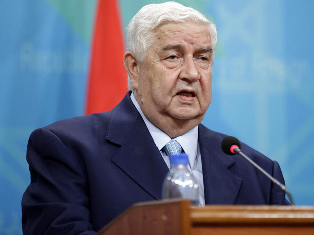 Syrian Foreign Minister Walid al-Moallem attends a press conference with his Iraqi counterpart, Hoshyar Zebari, not pictured, in Baghdad, Iraq, May 26, 2013.