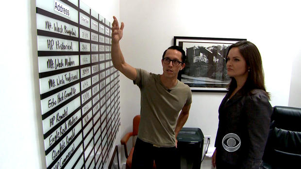 Matt Manner shows the production board in his office that lists all the homes he is flipping.