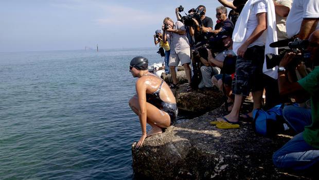 Australian swimmer Chloe McCardel jumps into the water at Hemingway Marina to start her swim to Florida from Havana, Cuba, Wednesday, June 12, 2013.