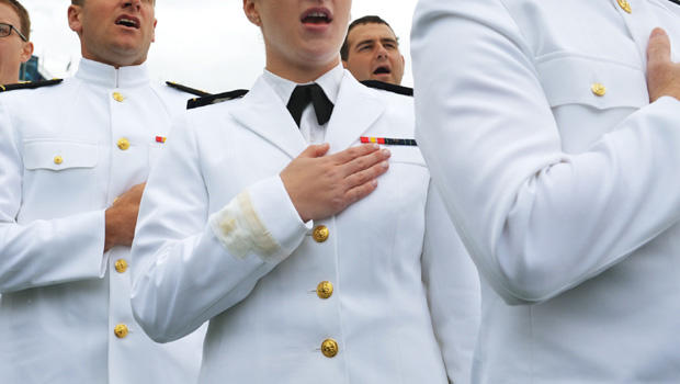 Graduates of the US Naval Academy sing the navy school song during the Naval Academy graduation ceremony at the Navy-Marine Corps Memorial Stadium on May 24, 2013 in Annapolis, Maryland. US President Barack Obama delivered the commencement address.
