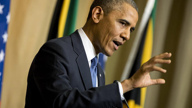 President Obama gestures during a news conference with South African President Jacob Zuma, not pictured, at the Union Building June 29, 2013, in Pretoria, South Africa.