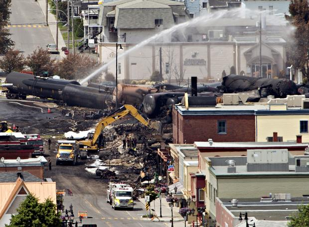 Searchers dig through the rubble for victims of a train derailment in Lac-Megantic, Quebec