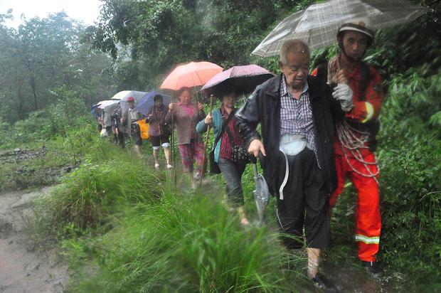 Rescuers evacuate residents from landslide-hit areas in Dujiangyan
