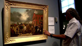 A man looks at an 1837 painting by Burnham Thomas Mickell at the Detroit Institute of Arts.