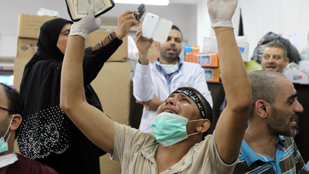 An Egyptian man mourns the death of a relative, shot dead in the Egyptian capital Cairo after violence erupted overnight, inside a Muslim Brotherhood field hospital July 27, 2013.