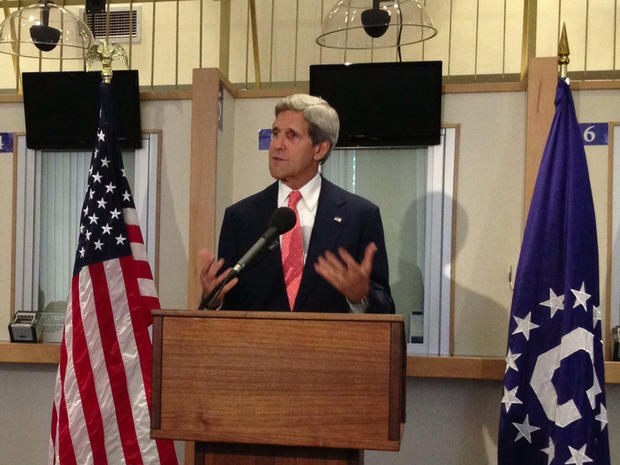John Kerry speaks to staff at the consular visa office of the U.S. Embassy in London