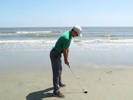 Luke Bielawski's last shot, with a biodegradable golf ball, sunk into the Atlantic.
