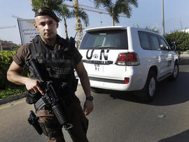 A Lebanese special forces policeman escorts the vehicles of U.N. experts upon their arrival at the private jet terminal at Beirut's international airport Aug. 31, 2013.