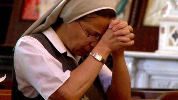 A woman prays at Al Zeytouna Greek Catholic Church in Damascus.